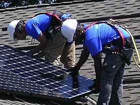 Valley Solar installers carefully install SunPower panels on the Invisimount Mounting System