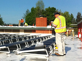 Valley Solar expert solar panel installers on JHS roof top