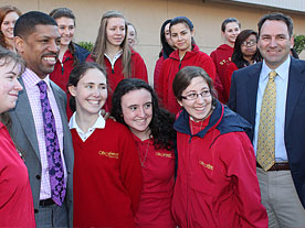 Major Johnson (l) and Brad Price (r), President of Valley Solar, with students of St. Francis High School.