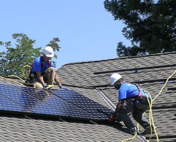 Valley Solar expert installers installing SunPower solar panels on roof of a home.