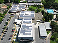 Aerial view of Jesuit High School's roof-mounted solar electric system